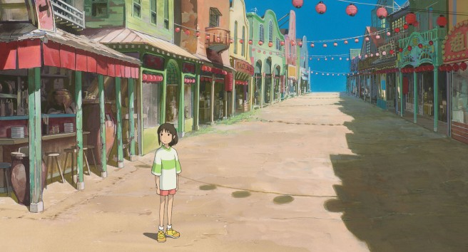 Chihiro stands lost in the ghost town in Spirited Away, the highest-grossing film in Japan.